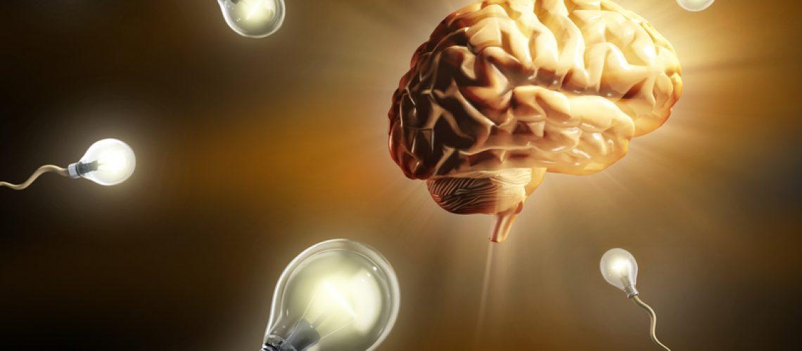 Light bulbs as sperm cells, as they fly toward an human brain. Digital illustration.